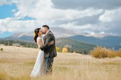 Fall mountain wedding at Deer Creek Valley Ranch in Bailey, Colorado. Ranch wedding with gorgeous aspens, a stagecoach and sunflowers! Elevate Photography
