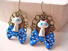 White cat  dangling earrings with blue bows by DinaFragola on Etsy, $25.00
