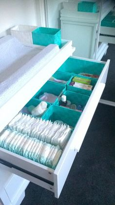 Boori Lucia change table  dresser with mint green storage compartments. After looking everywhere for suitable baskets, I managed to find the best ones at the Reject shop! They fit perfectly. #fitness