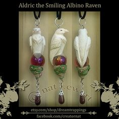 The Albino version of my Smiling Raven series, this is the morning, to the midnight colors of a typical, ebony-feathered raven.  I hand sculpted a smiling little raven(named Aldric), perched atop an Aurora Borealis, ruby-red glass, sphere. Below the orb, are winding branches and leaves, carved into base, with a shimmery, pale golden finish. Extremely fine detailed, one-of-a-kind piece, not created from a mold, and completely unique. When not being worn, would also make a lovely decor piece…
