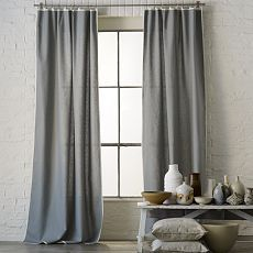 I like the white trim around the edge of the curtain. I could make that, easily.
