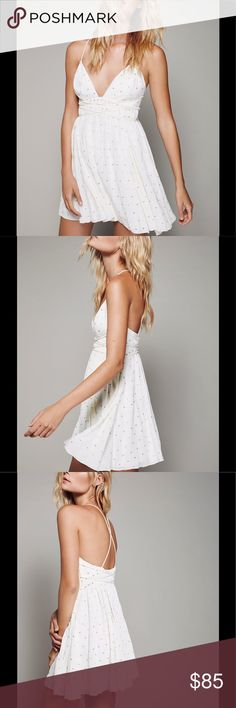 NWT Free People Lurex Dot Mini Dress NWT Mini dress featuring an all over Lurex dot pattern, plunging neck line with strapped details around the waist and crisscross back. Hidden zipper on the side , fully lined. This garment does have two pen marks shown on pictures. Light cream color. NO TRADES. Any questions please ask :) Free People Dresses Mini
