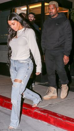 Cheer up! Kanye, 39, didn't look very happy as he left the eatery with his reality star wife. He was dressed in an all-black ensemble with a pair of Yeezy boots as he followed behind