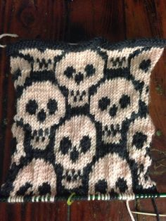 eeemachine340: I dID IT. I FINISHED THE FUCKING CHART AND I HAVR FIVE ROWS OF GARTER STITCH LEFT ON THIS AND THEN I GET TO START THE BACK PIECE. IM SO FUCKING HAPPY. HERES TGE FUCKING CHART I'M USUNG: http://www.ravelry.com/patterns/library/ossuary-chart