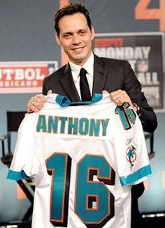 Marc Anthony celebrating minority ownership Miami Dolphins