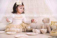 .little girl having tea party with her teddy bear - ADORABLE - love the phone prop