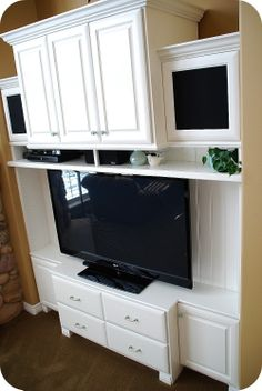DIY Entertainment Unit Redo to accomodate a big screen tv - love the fake panel on the back to hide the cables -