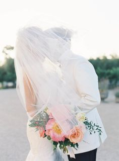 Under the veil: http://www.stylemepretty.com/2014/09/08/modern-tuscan-inspired-wedding-with-pops-of-color/   Photography: Jen Huang - http://jenhuangphoto.com/