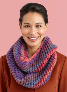This flattering cowl combines exciting self-striping Amazing yarn with a fun diagonal lace pattern for a standout accessory. This versatile project can also be worn as a hood on cooler days.