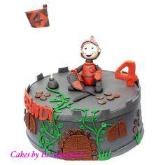 Riddertaart met een geboetseerde ridder zittend op zijn kasteel.