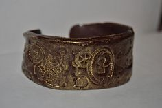 From Betsy Beckman, here ya go with a very cool Steampunk cuff.....made of polymer clay!  Texture comes from the nifty Lisa Pavelka Steampunk texture stamps carried at bsueboutiques.com in the polymer clay section!