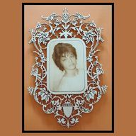 Monica: Engraving photo on frame.