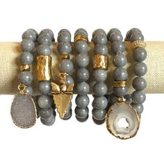 Color: Gray Speck This gray jade stone is so simple yet elegant. Beads measure 10mm and are strung on a thick elastic cord. One size fits most