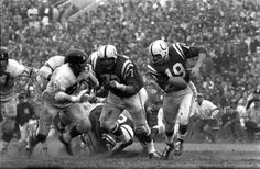 Baltimore Colts quarterback Johnny Unitas ( makes a play versus the New  York Giants during the 1959 NFL Championship game at Memorial Stadium. 19dee855a