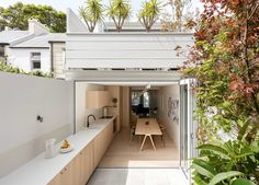 Interesting extension of the kitchen onto the deck. Surry Hills House | Benn + Penna Architecture | Est Living