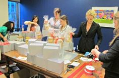 Host a gift wrapping party, improve employee morale