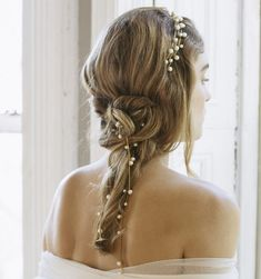 Surreal and oh-so-special! We've fallen for the Eliora, and we're not alone. The delicate strands of pearls can be incorporated into braids and buns, or worn loose with the hair.   Free Shipping in the USA. We ship worldwide! Orders ship within 3-5 business days. Please email shop@jenniferbehr.com or call 718-360-1875 to request expedited shipping. We are a small team and are happy to answer your questions 10am - 6pm, Monday - Friday! $925.00