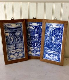 This is a listing for 3 delft blue framed handpainted tiles. One says Worstmaker, PateBakker, & Hamroker. Convo If you wish to purchase only one. All have original manufacture stickers on back, stamped MOSA HOLLAND. All are in a dark stained wood frame with triangle hook for hanging. All are in excellent vintage condition ready to place in kitchen, dining room , bookshelf, or any room for lovely blue & white wall decor!  Measures each 8.5 height X 4.75 wide total, tile measures almost 8 X 4…