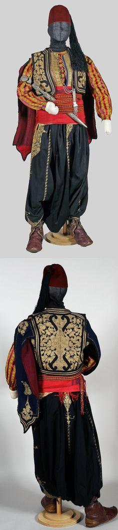 Costume of a bodyguard-coachman.Istanbul,c.1900. Silk shirt&bodice; embroidered large trousers&jacket 'with eagle sleeves';red silk 'kuşak'(belt);woollen 'carpana kemer'(card woven waist band). Ottoman Empire. Turkey