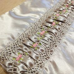 Smocked insert with beautiful embroidery in the middle of the puffing.