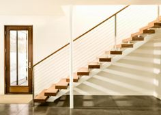 Understand the challenging feng shui energy of a staircase - in either home or office - and explore many practical feng shui solutions to help create better energy. These tips are especially helpful if you have a staircase in the center of your home or a staircase directly facing the front door.