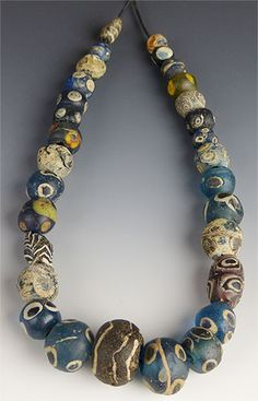 Wonderful little strand of Islamic-era glass beads from the ancient capital of Mali, Djenne. These beads date to somewhere between 800 - 1200 AD. They are extremely photogenic, and in good (although n