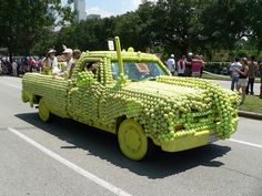 It appears that tennis balls were used to cover this truck in a decorative fashion!