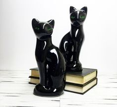 Vintage Ceramic Black Cats Statues | Set of 2 by sparkhausvintage on Etsy https://www.etsy.com/listing/458812042/vintage-ceramic-black-cats-statues-set