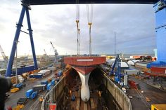 Upper bow section lifted into place by QEClassCarriers, via Flickr