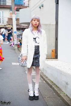 22-year-old Kano on the street in harajuku wearing a fluffy coat over a LilLilly top, a leather skirt from Nadia Harajuku, and Cannabis x k3 x Vargas platform sandals. Full Look