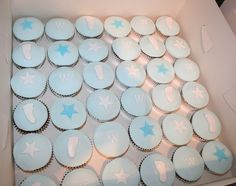 Chocolate and vanilla cupcakes with baby blue icing and baby footprints, intial and stars Christening Cupcakes, Baby Boy Christening, Baby Staff, Blue Icing, Cupcake Cakes, Baby Cakes, Baby Footprints, Vanilla Cupcakes, Baptism Ideas