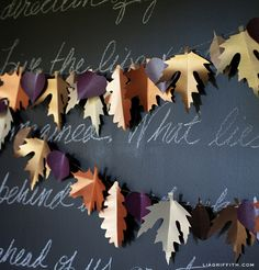 Gorgeous DIY Paper Leaf Garland.  I found all the paper colors here too. http://www.paperandmore.com They let you order singles (as many as you want) and have flat $1 shipping for them.  They're like 50 -75 cents a sheet, great for when you need several colors.