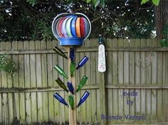 Love this version of a bottle tree with the whirly-gig on top. I'm sure I can find somewhere in the garden for this