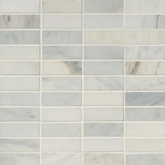 """1x3+Arabescato+White+Carrara+Marble+Brick+Pattern+Honed+Mosaic+Tile+-+This+fine+quality+Carrara+marble+brick+pattern+tile+is+a+flawless+way+to+give+a+classy+look+to+any+space.+The+white+Carrara+marble+mosaic+tile+comes+in+chips+of+1+in.+x+3+in.+mounted+on+a+mesh+net,+the+chips+are+arranged+to+make+an+interlocking+brick+pattern+tile.+Each+mosaic+tile+is+12""""x12""""mesh+mounted+mosaic+tile,+which+approximately+covers+1+sqft.+area.+This+tile+is+honed+finish+which+makes+it+muted+and+le"""