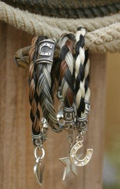 Horse Hair Bracelets @Tiffany Gonzales we need to figure out how to make these...without the dangle charms :/ me no likey lol