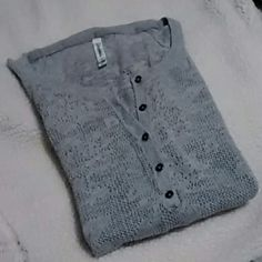 Aeropostale Knit Top Lovingly worn and in excellent condition! Aeropostale gray knit top long sleeves with 5 buttons in the front.  Ribbed bottom. Definitely need a tank underneath. Size Medium Aeropostale Sweaters Crew & Scoop Necks