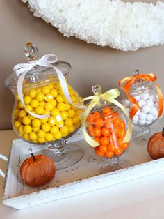 Fill apothecary jars with bright colored candy. It makes an eye-catching display and your guests can help themselves.