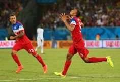 From right: John Brooks of the United States celebrates scoring his team's second goal with Fabian Johnson during the 2014 FIFA World Cup Br...