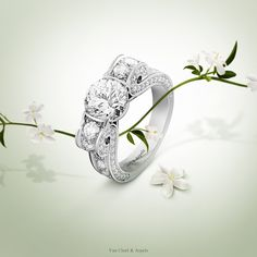"""Van Cleef & Arpels unique solitaire """"Une Soirée à l'Opéra"""" - platinum, diamonds, one round diamond 2,01 carats - evokes the passion of the Maison for the opera and ballet, and is inspired by the architecture of the legendary Opéra Garnier. #VCAbridal #EnchantingLoveStories Find more about diamonds' selection by Van Cleef & Arpels: http://goo.gl/9ktBJV"""