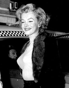 Marilyn Monroe getting into a taxi in New York City