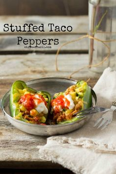 Stuffed Taco Peppers. All of the goodness from a taco stuffed inside a flavorful bell pepper. ohsweetbasil.com