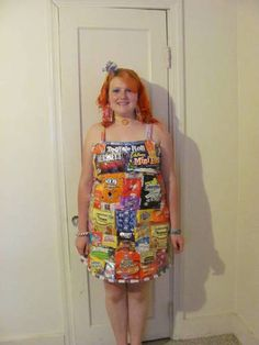 """dress made from candy wrappers, chip bags, and Raman noddle bags, the model/designer calls her """"wrapper"""" dress. Her earings, necklace, and the flower on her headband are also made of wrappers."""