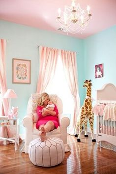 Aqua walls against the light pink ceiling looks so graceful for a nursery. Its a unque way. you could later on paint the ceiling and make it a boys room. the aqua is so soft. the giraffee kind of throws the room off but my eye is drawn to the ceiling and wall.