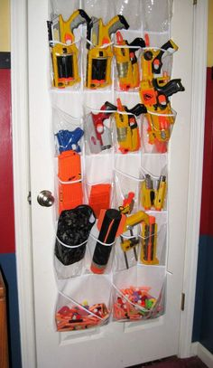 So many nerf guns--so little time! So here are loads of fun ideas on nerf gun storage so you can get them off the floor and organized! Nerf Birthday Party, Nerf Party, Creative Toy Storage, Storage Ideas, Easy Storage, Nerf Gun Storage, Airsoft Storage, Shoe Storage, Pistola Nerf