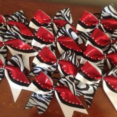 Bring it on bling added Swarovski stones to cheer bows for a Texas cheer team! Email DeeDee at bringitonbling@yahoo.com to make your teams cheer bows stand out! They are amazing under the stage lights!!!