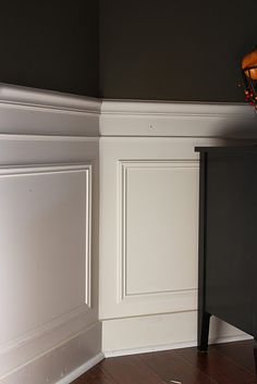 pretty simple diy wainscotting using picture frame molding. already have these materials in the garage--would just need to measure and cut!