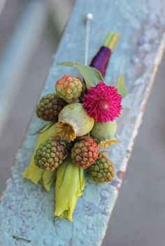 Lisianthus bud, poppy pods, raspberries, and gomphrena