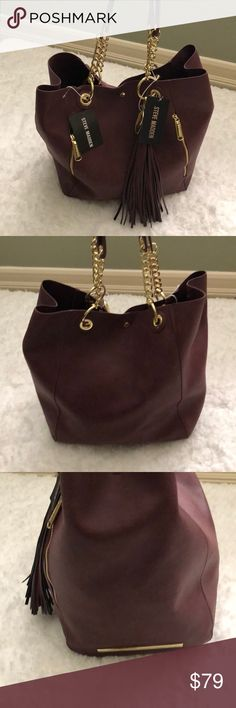 Steve Madden NWT wine color handbag/ make up case Steve Madden NWT wine color handbag and make up case with gold accent.   Make up bag detaches.    Bag is 19x13.   Case is 9.5x11 approx Steve Madden Bags Satchels