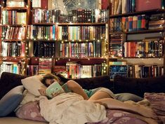 Cool using of fairy lights on a bookcase.