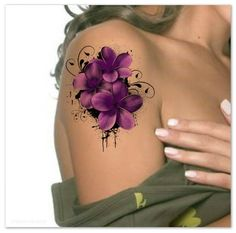 Colorful flowers tattoo on a girl's shoulder and upper arm ...